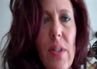 Redhead stepmom rides on her stepson dick