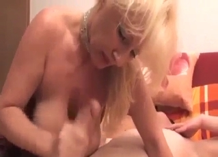 Blonde auntie jerks off my prick with love