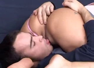 Happy young sister is tasting her brother's prick